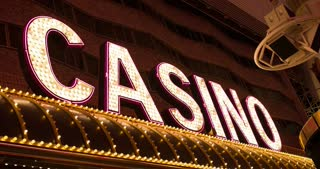 Casino lights on building sign flashing 4k