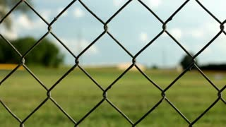 Chain link fence at park dolly shot