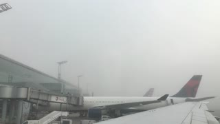 Chicago airport with fog looking out over airplanes 4k