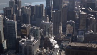 Chicago city buildings seen below aerial shot slow motion