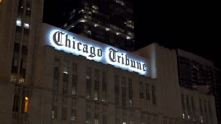 Chicago Tribune building in downtown Chicago Illinois at night 4k