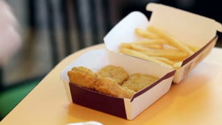 Chicken Nuggets and French Fries eaten by child