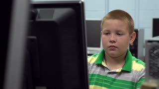 Child in computer lab at school