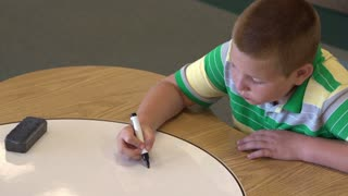 Child practicing simple math