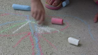 Child using Sidewalk Chalk