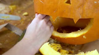 Child working on pumpkin for Halloween