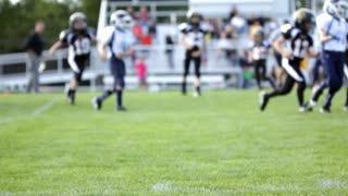 Children football game focus on sideline