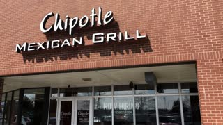 Chipotle Mexican Grill entrance sign tilt 4k