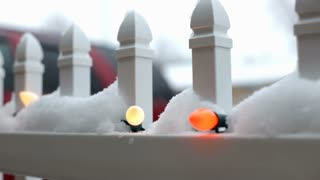 Christmas lights outside in the snow