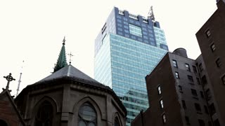 Church and skyscraper in background