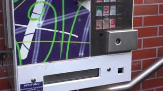 Cigarette machine located in Germany tilt shot 4k