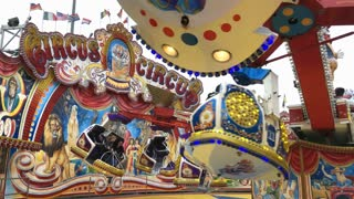 Circus Circus spinning carnival ride at Dipppemess in Frankfurt Germany 4k