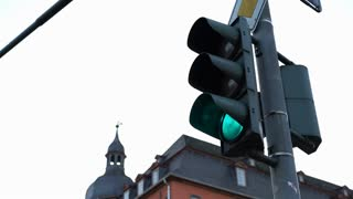 City intersection light turning from green to red 4k