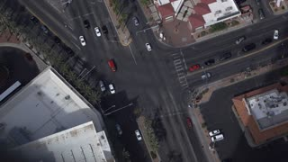 City intersection with traffic at light aerial view 4k