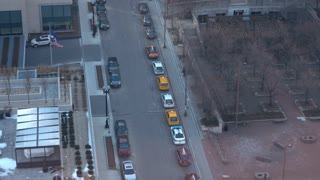 City streets of downtown Chicago with Taxi cabs lined up overhead view 4k