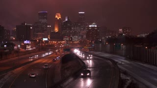 City traffic entering and leaving Minneapolis at night 4k
