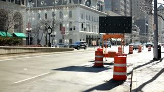City traffic with flashing caution arrow