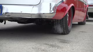 Classic car focus on exhaust smoke