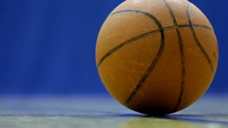 Close up of Ball sitting on court sideline