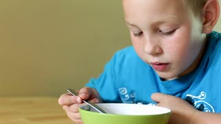 Close up of Boy eating cereal