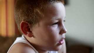 Close up of Child's face playing a Video Game