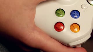 Close up of Child's hand on Video Game Control