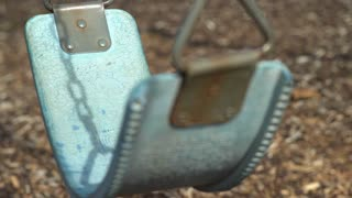 Close up of empty playground swing 4k
