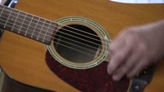 Close up of Guitar Played