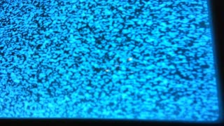 Close up of static on old television screen