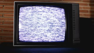 Close up of Static TV with Brick background