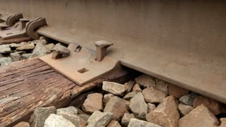 Close up on railroad track dolly shot