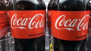 Coca Cola bottled soft drink in vending machine
