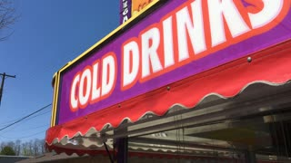 Cold drink signs at carnival food stand 4k