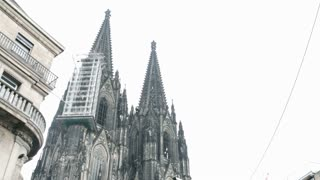 Cologne Cathedral with busy street below