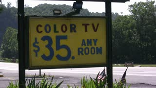 Color TV Motel sign next to road