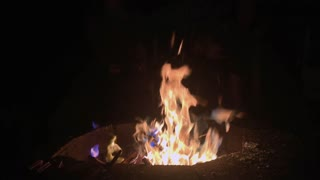 Colorful flames burning in fire pit 4k