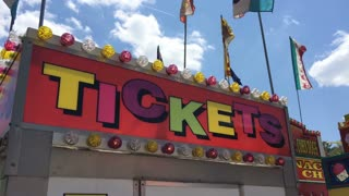 Colorful tickets sign at carnival