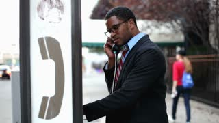Conspicuous Man on pay phone in city