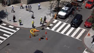 Construction Crew working on intersection sewer system at in Washington DC 4k