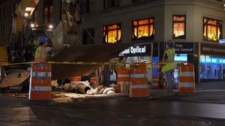 Construction crew working on streets in New York City at night 4k