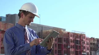 Construction engineer on tablet