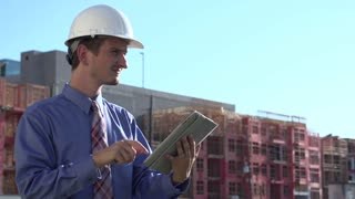 Construction engineer using tablet