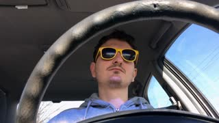 Cool guy with sunglasses driving car 4k
