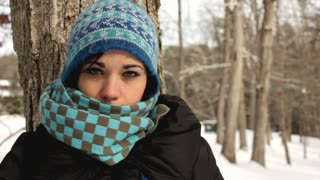 Cose up of Girl with scarf against tree