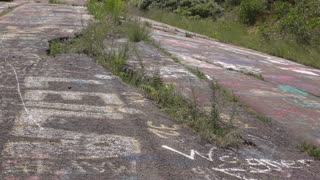 Cracked road in abandoned city with underground coal mine fire 4k