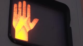 Crosswalk sign close up on hand and walking symbol 4k