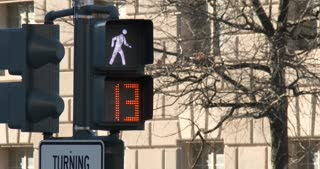 Crosswalk signal in downtown of city going from walk to the red hand 4k