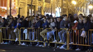 Crowd against fence waiting for Fallas fireworks 4k