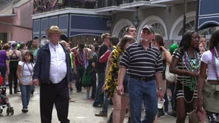 Crowd of people walking down Bourbon Street slow motion