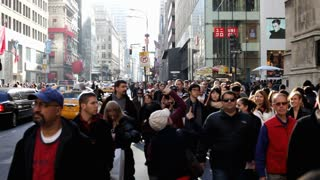 Crowd of people walking on nyc sidewalk